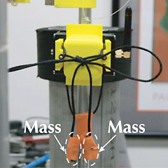 Masses on shoelace ends in UC Berkeley test rig